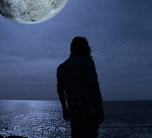 silhouette of a sad lone woman with a full moon on a cliff edge by morrbyte