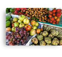 Variation of tropical fruits on stall at market Canvas Print