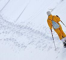 Woman snowshoeing by Sami Sarkis