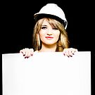 Female architect holding blank blueprint design by Ryan Jorgensen