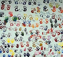 Handprints on a wall in Maribor - Slovenia by Arie Koene