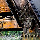 Rusted, Grungy Iron Railroad Trestle by Kenneth Keifer