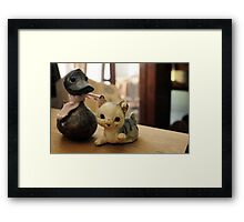 Cat and duck Framed Print