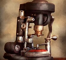 Optometry - Lens cutting machine by Mike  Savad