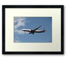 Airplane in the air Framed Print