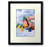world in hands with sky Framed Print