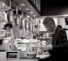 Quick meal at the station - Japan by Norman Repacholi