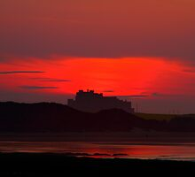 Sunset over Bamburgh Castle by Paul Bettison