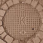 Gingham K:TM&H Manhole by Mary-Elizabeth Kadlub