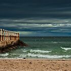 A stormy sky over the bay. by Adrian Cusmano