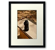 Nikon zoom lens on a stone bench Framed Print