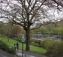 Couple walking on a wet path in Edinburgh near the Train Station by ashishagarwal74