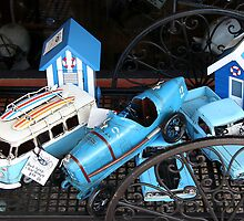 Vintage tin cars and bathing boxes by Maggie Hegarty