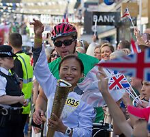 Janet Fletcher carries the Olympic Torch in Bromley Kent by Keith Larby