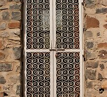 Metal door and stone building by ashishagarwal74