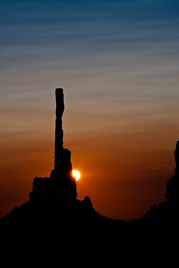 Sun peeks behind Totem Pole by Owed to Nature