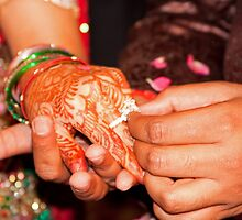 Putting the gold and diamond engagement ring on the finger of the lady by ashishagarwal74