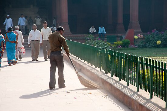 Sweeping the path in front of one of the buildings inside the Red Fort by ashishagarwal74