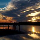 Man On The Pier Over Looking The Sunset by Kathy Baccari