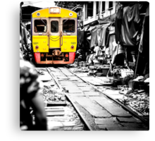 Train coming toward the market with food still on the ground. Canvas Print
