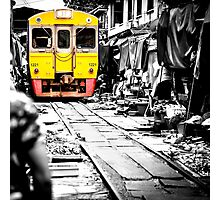 Train coming toward the market with food still on the ground. Photographic Print