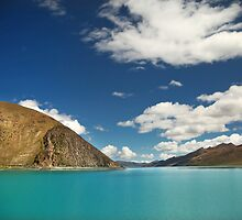 Scenic Tibetan mountains and bright blue water by ieatstars