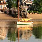 Catboat and rippled water reflections by Roupen  Baker