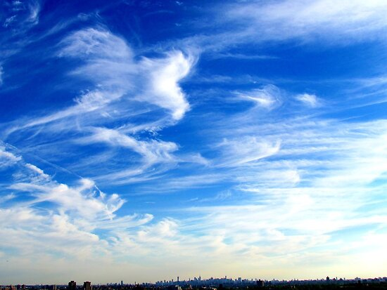 Drifting clouds over New York City  by Alberto  DeJesus