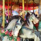 Little Boy on Carousel by Susan Savad
