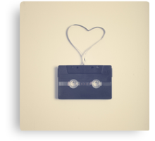 Music retro black cassette and tape heart shaped Canvas Print