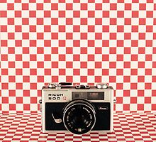 Retro - Vintage Black Camera on Red Chequered Pattern Background  by Andreka