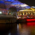 Blue canopy and river water at Clarke Quay in Singapore by ashishagarwal74