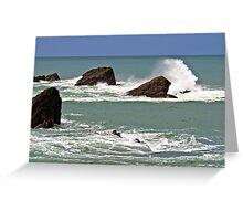 Waves crashing against rocks Greeting Card