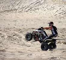 Quad bike doing wheelie by BigAndRed