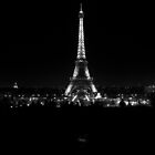 Eiffel tower illuminated at night in B/W by Pat Garret