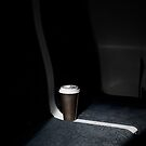 Coffee Cup on Train Seat by handyandypandy