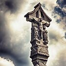 Crucifix and clouds by Vicki Field