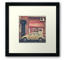 Beige Volkswagen Bug and a lovely Pink Shop (Vintage - Retro Urban Photography) Framed Print