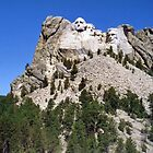 Mount Rushmore with Pine Trees Below and Blue Sky by aweddingtheme