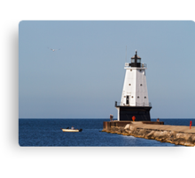 Ludington Light and Fishermen Canvas Print