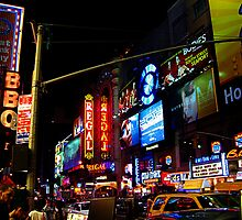 Bright Lights and Colors Of 42nd Street at Night by Jane Neill-Hancock