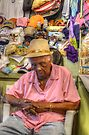 Straw Market in Nassau, The Bahamas... Sleeping at work by 242Digital
