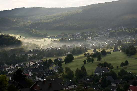 Early morning mist clearing 3, Siegerland, Germany. by David A. L. Davies