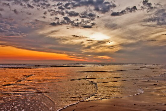 sunset at the beach by ketut suwitra