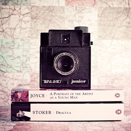 Retro - Vintage Black Camera on Beige Background and books  by Andreka