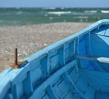 Blue boat on the beach by pixelnest