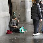 busking in Melbourne city by Trevor Corran