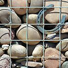 Rock wall with horseshoe by Jeff Knapp