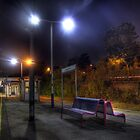 Railway station platform at night by Phill Sacre