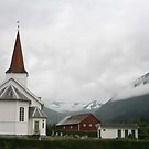 Norwegian Church in misty mountains and snow by Grace Johnson